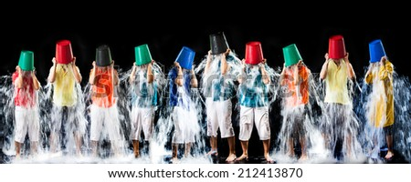 Panorama of man pour a bucket of ice topped their head on a black - stock photo