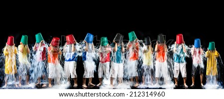 Panorama of man pour a bucket of ice topped their head on a black background. - stock photo
