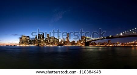 panorama of Manhattan Skyline at evening after sunset seen from Brooklyn Bridge Park, New York City, USA - stock photo