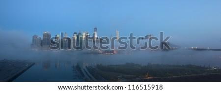 Panorama of Manhattan skyline in fog - stock photo