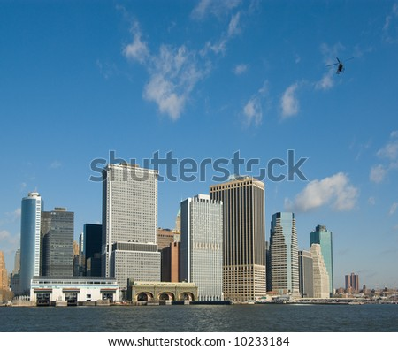 panorama of manhattan with flying helicopter, new york, usa