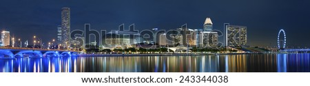 Panorama of Marina Bay of Singapore City at night - stock photo