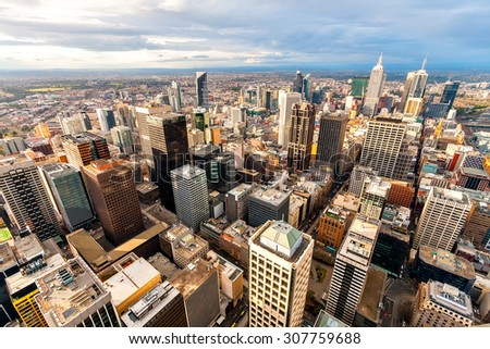 Panorama of Melbourne's city center from a high point. Australia. Beautiful panorama of skyscrapers in the city center and suburbs to the horizon. Sunset and blue clouds. - stock photo