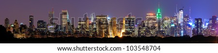 Panorama of midtown Manhattan at night in New York City - stock photo