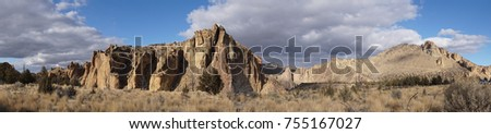 panorama of Monument and other jagged peaks  along the Crooked River at Smith Rock State Park, Oregon