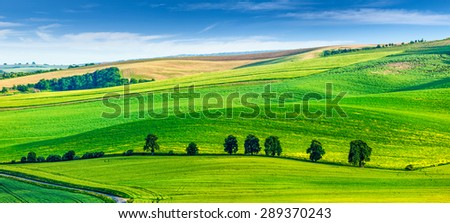 Panorama of Moravian rolling landscape with trees. South Moravia, Czech Republic