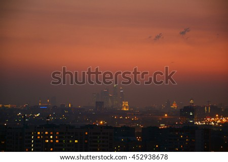 Panorama of Moscow city complex of skyscrapers at evening in night illumination, Moscow, Russia. Business Center Of Modern Moscow with beautiful sunset on background. - stock photo