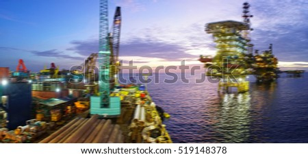 Panorama of motion blur pipelay barge with oil and gas rig platform in the middle of South China Sea during sunrise scene.Construction of production process in the sea and power energy of the world.
