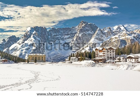 Panorama of mountain range from Misurina Lake resort in Dolomites, Italy in winter
