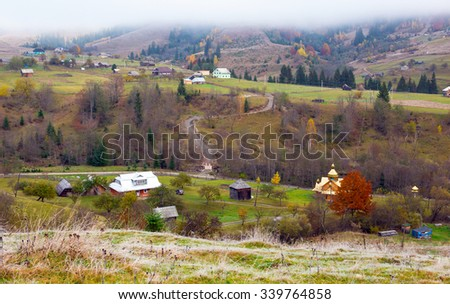 Panorama of Mountain Village Late Autumnal Colors of Forest and Orthodox Church on Foreground