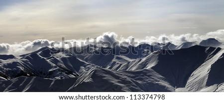 Panorama of mountains at sunset. Caucasus Mountains, Georgia, Gudauri. - stock photo