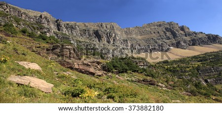 Panorama of Mountains in Glacier National Park on the Hidden Lake Trail - stock photo