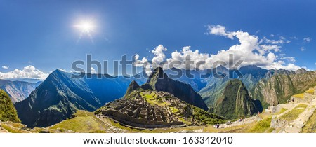 Panorama of Mysterious city - Machu Picchu, Peru,South America. The Incan ruins and terrace. Example of  polygonal masonry and skill - stock photo