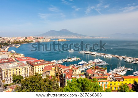 Panorama of Naples with Mount Vesuvius and the Bay. View from a high point. The coastal part of Naples, piers with yachts. Beautiful bay with views of Mount Vesuvius in summer sunny day.