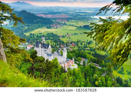 Panorama of Neuschwanstein castle from mountain above view - stock photo