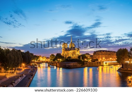Panorama of Notre Dame Cathedral at dusk in Paris, France - stock photo