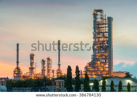 Panorama of Oil refinery and storage tanks at twilight