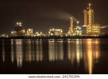panorama of Oil refinery with reflection, petrochemical plant - stock photo