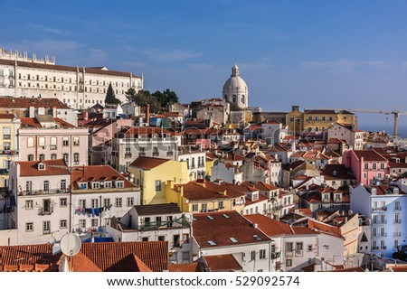 Panorama of old traditional city of Lisbon with red roofs. Portugal.