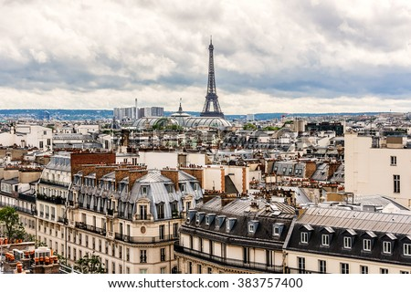 Panorama of Paris on the Sunset. View from Printemps store. France - stock photo