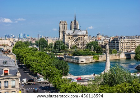 Panorama of Paris with Cite island and Cathedral Notre Dame de Paris on the background. View from Arab World Institute. France. - stock photo