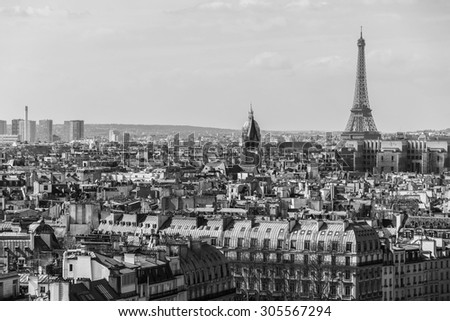 Panorama of Paris with Eiffel tower on the background. View from Cathedral Notre Dame de Paris. France. Black and white. - stock photo