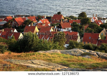 Panorama of picturesque small town Gudhjem with red roofs by early morning, Bornholm, Denmark