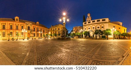 Panorama of Plaza Virgen de los Reyes in Seville at night, Andalusia, Spain