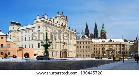 Panorama of Prague Castle and Archbishop's palace in winter with snow - stock photo