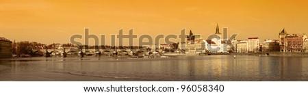 Panorama of Prague Charles Bridge old style in orange - stock photo