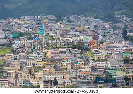 Panorama of Quito with houses in the mountain during the day with a blue sky. Ecuador 2015. - stock photo