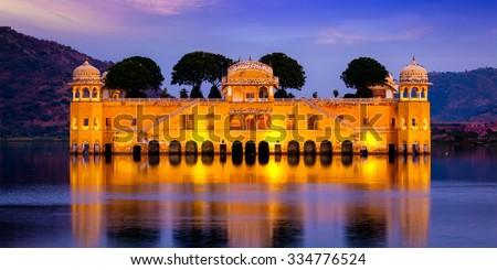 Panorama of Rajasthan landmark - Jal Mahal (Water Palace) on Man Sagar Lake in the evening in twilight.  Jaipur, Rajasthan, India - stock photo