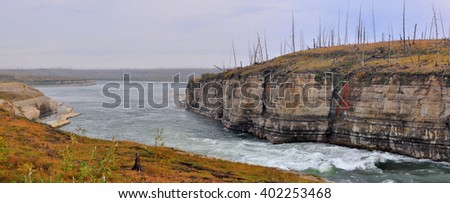 Panorama of rapid in a rocky canyon. The Fish river canyon on the Putorana plateau. - stock photo