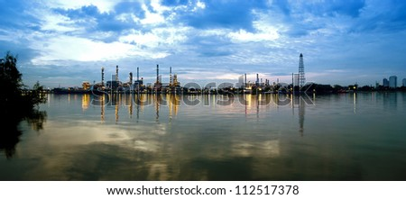 panorama of River and oil refinery factory with reflection in Bangkok, Thailand. - stock photo
