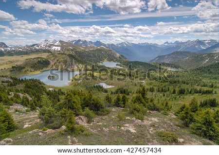 Panorama of Rock Isle Lake, Laryx Lake, and Grizzly Lake from Standish Viewpoint in Sunshine Meadows, Mt. Assiniboine Provincial Park, British Columbia, Canada - stock photo