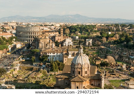 Panorama of Roman Forum ruins and Colosseum, Italy - stock photo
