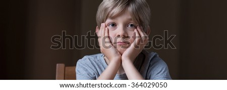 Panorama of sad lonely kid with social problem - stock photo