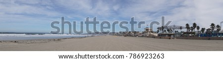 Panorama of sandy coast and surf at Mission Beach, San Diego, California