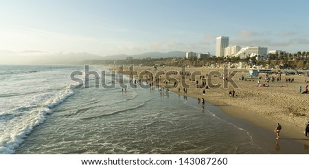 Panorama of Santa Monica Beach With People and Skyline - stock photo