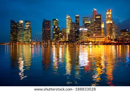 Panorama of Singapore downtown with reflection in a river - stock photo