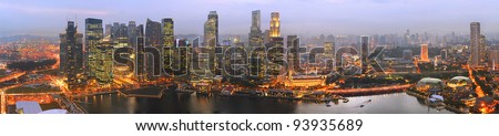 Panorama of Singapore from Marina Bay Sand Resort at beautiful sunset - stock photo