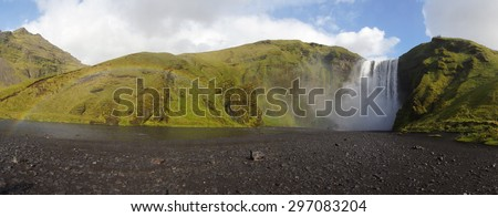 Panorama of Skogafoss in Iceland, beautiful clear sunny day, rainbow