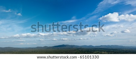 Panorama of sky above small mountains, covered with trees. Sri Lanka