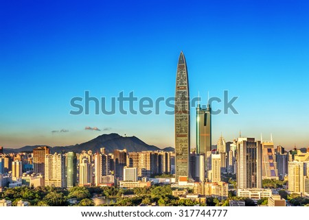 panorama of skyscrapers in a modern city under blue sky