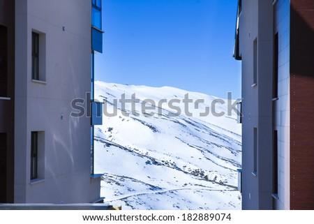 Panorama of snow mountain landscape with blue sky from Sierra Nevada, Pradollano, Granada. - stock photo