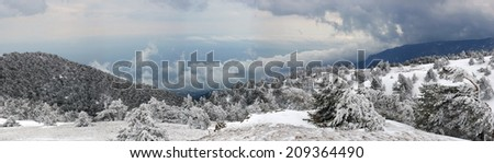 Panorama of snow mountain landscape with blue sky in the morning. Russia, Crimea