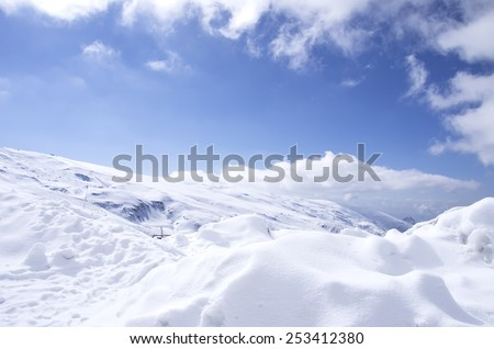 Panorama of Snow Mountain Range Landscape with Blue Sky - stock photo
