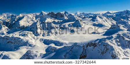 Panorama of Snow Mountain Range. Landscape with Blue Sky at Mt Fort Peak Alps Region Switzerland - stock photo
