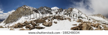 Panorama of snowy Sierra Nevada Mountains near Bishop California including Mount Locke Checkered Demon Mount Humphreys and Basin Mountain - stock photo