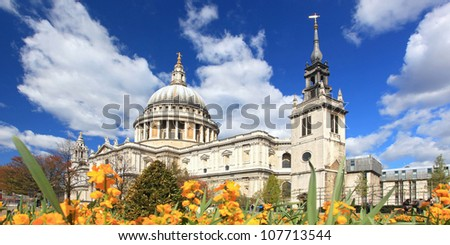 Panorama of St. Paul Cathedral with Yellow Flower garden in London England United Kingdom - stock photo